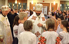 Major Archbishop Sviatoslav Shevchuk greets some of the 600 children from Ukrainian bilingual programs at schools in the Edmonton area prior to celebrating the Divine Liturgy June 6 at St. Basil's Church. Edmonton Bishop David Motiuk (left) looks on.