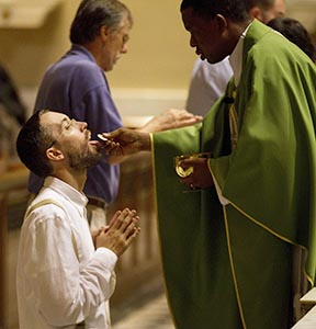 Kneeling to receive Communion is a beautiful gesture, but so is standing when it is properly understood.