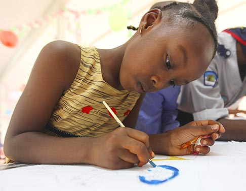 A girl from Tawargha, Libya, draws as she celebrates World Refugee Day at a refugee camp hosted by the UN High Commissioner for Refugees in Benghazi, Libya, June 20. Currently, the world has an estimated 15.2 million refugees, with about half of them children under 18. Another 27.3 million people are internally displaced within their own countries and are seeking asylum elsewhere. Canada ranks ninth among world nations as a destination for refugees.