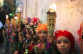 Palestinian girls hold torches during a celebration to mark the breaking of the fast during the holy month of Ramadan in Jerusalem July 26.