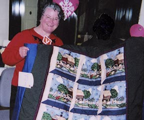 Mable Solomon displays one of the many quilts made by inmates at the Edmonton Institution for Women.
