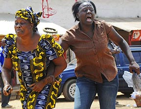 Women run from the scene of a church bombing in the Nigerian city of Jos in March