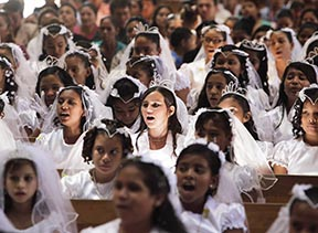 Girls attend First Communion in Nicaragua: In two decades time, the Catholic population of the Americas has increased more than 25 per cent.