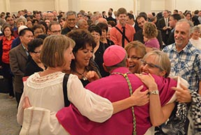 Hundreds of family friends and fans of Auxiliary Bishop Gregory Bittman lined up to greet the new prelate and receive his blessing following his ordination Mass Sept. 3 at St. Joseph's Basilica.