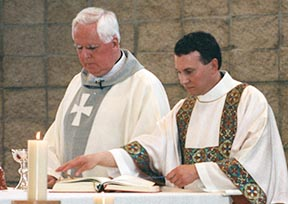 Deacon Greg Bittman assists Archbishop Joseph MacNeil at the June 1996 Mass at Holy Family Church in St. Albert at which he was ordained a deacon