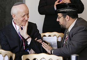 Rabbi Irving Greenberg, left, and Imam Yahya Hendi, practise the Three Testaments' premise by listening to each other at the Pope John II Cultural Centre in Washington.