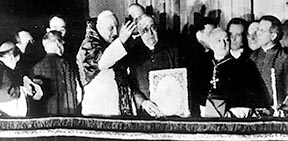 Pope John XXIII is seen blessing the crowd in St. Peter's Square following his election on Oct. 28, 1958.