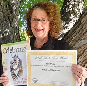 Edmonton-based editor of Celebrate! Bernadette Gasslein displays the magazine's final issue along with a recent award from the Catholic Press Association.