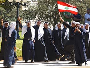 Men celebrate after Pope Benedict arrives at the Baabda Presidential Palace for meetings with Lebanese leaders southeast of Beirut Sept. 15.