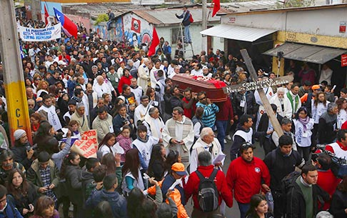 The casket of Fr. Pierre Dubois, a French priest who served in one of Santiago's poorest neighborhoods, is carried through a neighborhood in Santiago, Chile, Oct. 1. Dubois, a defender of human rights who was expelled for a time, died Sept. 28 at the age of 81.