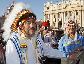 Harry Lafond of Muskeg Lake Sask., and chief Wilton Littlechild wait for the start of the canonization Mass in St. Peter's Square at the Vatican Oct. 21. At the Mass, Pope Benedict canonized St. Kateri Tekakwitha, the first North American aboriginal saint.