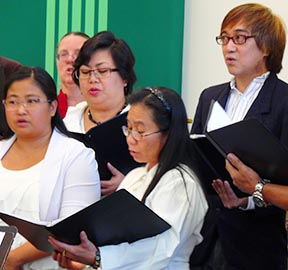 The Sacred Heart choir sang familiar hymns during the Mass.