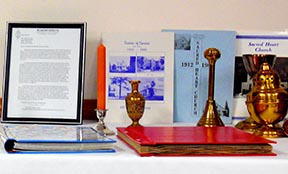 A display table included various artifacts, including a history of the Sisters of Service and a history of the parish.