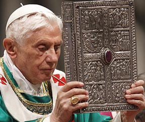 Pope Benedict holds the Book of the Gospels during the closing Mass of the Synod of Bishops.