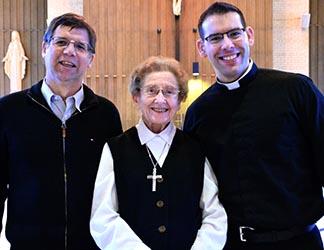 John Shores (left) and Sr. Elizabeth Kass (centre) see Matthew Hysell's ordination to the priesthood as an answer to their prayers.