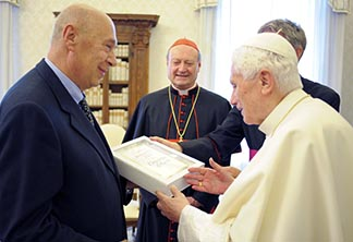 Pope Benedict holds a copy of his book Jesus of Nazareth: The Infancy Narratives as he talks with RCS Publisher Paolo Mieli and Cardinal Gianfranco Ravasi, president of the Pontifical Council for Culture, at the Vatican Nov.20.