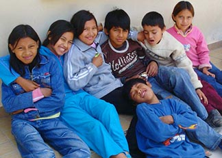 Children who lived in the neighborhood near the church where Sara Michel worked in Bolivia came to the church at every opportunity to hang out, learn something or to play.