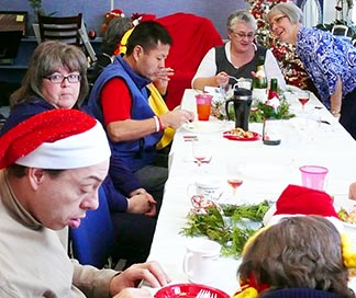 Residents of L'Arche Edmonton enjoy their Christmas luncheon at Fulton School.