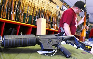 A Palmetto M4 assault rifle is seen at a gun store in Parker Colo. A new survey shows 62% of U.S. Catholics favour stricter gun control.