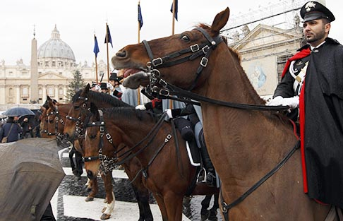 Horses and their riders attend an event for the blessing of animals outside St. Peter's Square in Rome Jan. 17. Cardinal Angelo Comastri blessed animals brought by members of an association of farmers and ranchers in an event called the