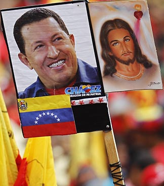 Images of Venezuelan President Hugo Chavez and Jesus are held up at a rally in Chavez's honour outside Miraflores Palace in Caracas Jan. 10.