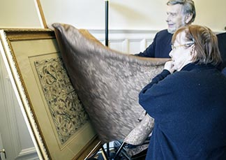Helen Smith and Fr. Jacques Monet display the 17th century veil Smith bought in an antique store in rural Ontario.