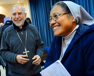 Sister Orella Narag from the Philippines, who works with Filipino migrants, at the West Bank campus of Bethlehem University, chats with a visiting American bishop Jan 9.