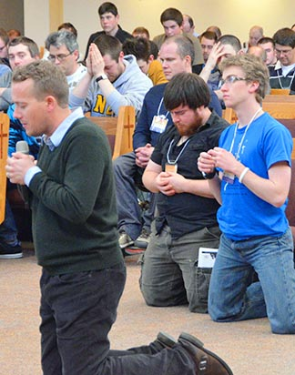 Catholic apologist Matthew Fradd leads men and youth in prayer during the Men of Integrity Conference at Holy Trinity Parish.