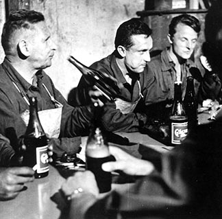 A worker-priest (centre) has a beer break with his fellow workers on a late night shift at an Austrian steel plant in 1971.