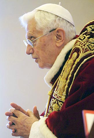 Pope Benedict attends a Feb. 11 meeting with cardinals at the Vatican announcing he will resign at the end of the month.
