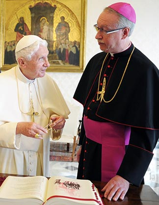 Pope Benedict talks with Edmonton Archbishop Richard Smith in his role as president of the Canadian Bishops in November 2011.