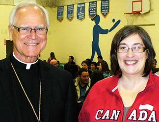 Archbishop James Weisgerber and Erin Kinsella at a meeting with Confirmation candidates.