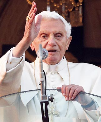 Pope Benedict XVI blesses people gathered in the town square after arriving in Castel Gandolfo, Italy, Feb. 28. It was his final public appearance before he drew to a close his papacy.