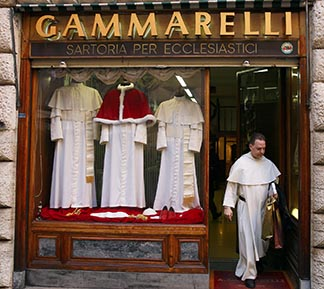 Three sizes of cassocks for the future pope are displayed in the Gammarelli clerical tailor shop.