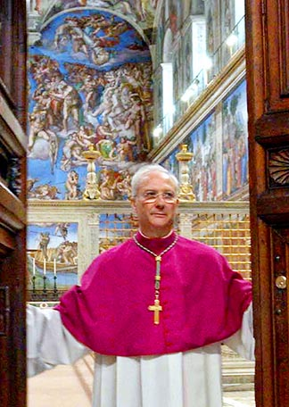 Archbishop Piero Marini closes the doors to the Sistine Chapel as the cardinals began the 2005 conclave that elected Pope Benedict XVI.