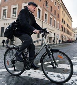 Cardinal Philippe Barbarin of Lyon, France, rides his bicycle to a general congregation meeting at the Vatican March 11.