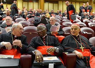 Italian Cardinal Giovanni Battista Re, Nigerian Cardinal Francis Arinze and Portuguese Cardinal Josz Saraiva Martins are seated in synod hall at the Vatican March 7 for one of several general congregation meetings being held ahead of the conclave.