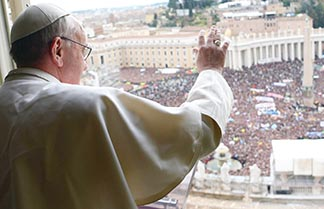 Pope Francis waves to the crowd of at least 150,000 from the window of his private apartment as he leads his first Angelus in St. Peter's Square March 17. His Angelus talk was one of several that he gave during his first days as pope.