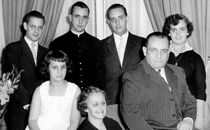 Bergoglio, second from left in the rear, is seen as a young priest with his family in this undated photo.