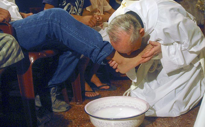 Cardinal Jorge Bergoglio washes and kisses the feet of residents of a shelter for drug users during Holy Thursday Mass in 2008 at a church in a poor neighbourhood of Buenos Aires.