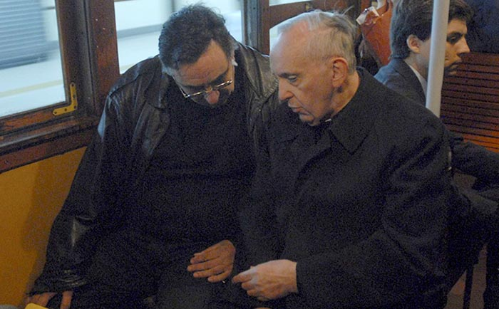 Cardinal Jorge Mario Bergogoli, right, is pictured traveling by subway in Buenos Aires in 2008.