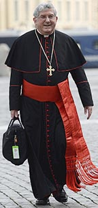 Cardinal Thomas Collins walks through St. Peter's Square March 9.