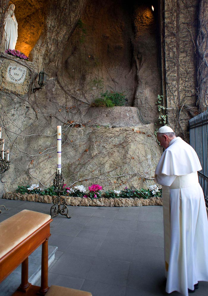 Pope Francis prays at Lourdes Grotto in the Vatican Gardens March 16.