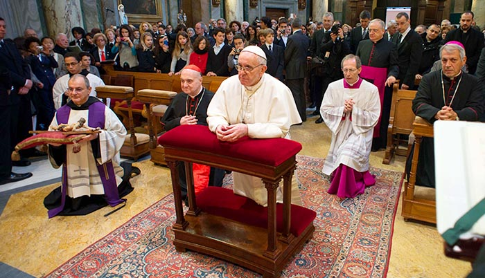 Pope Francis prays as he celebrates Mass at St. Anne's Parish within the Vatican March 17.