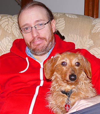 Fr. Mike Mireau, here shown with his dog Nemo, says he is undergoing both chemotherapy and Nemotherapy.