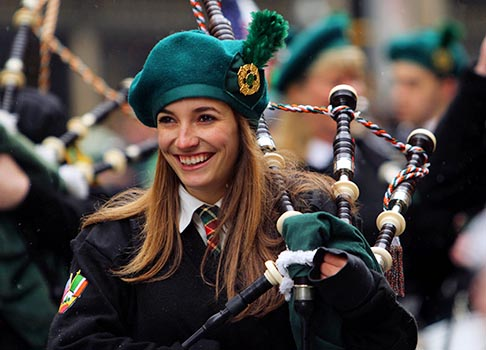 Liz Miller of the Manhattan College Pipes & Drums smiles as the band takes a break during the 252nd annual St. Patrick's Day Parade in New York March 16.