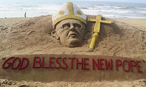 A sand sculpture of the newly-elected Pope Francis, created by Indian artist Sudarshan Patnaik, is seen on a beach in Puri, India, March 14.