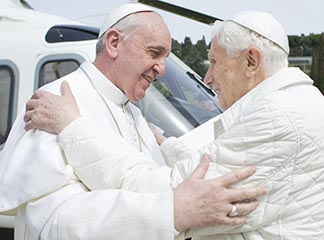 Pope Francis embraces emeritus Pope Benedict XVI at the papal summer residence in Castel Gandolfo, Italy, March 23.
