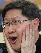 Philippine Cardinal Luis Tagle of Manila reacts to a question during a March 21 news conference.