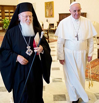 Pope Francis walks with Ecumenical Patriarch Bartholomew of Constantinople March 20.